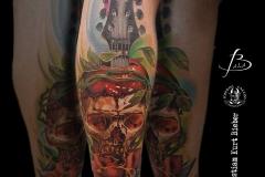 inferno-tattoo-barcelona-christian-kurt-bieber-realismo-grande-pierna-gemelo-calavera-color-brazo