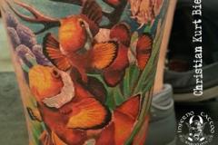 inferno-tattoo-barcelona-realismo-color-christian-kurt-bieber-grande-pierna-peces-nemo-y-coral