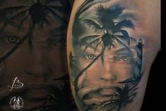 inferno-tattoo-barcelona-realismo-negro-gris-christian-kurt-bieber-grande-brazo-paisaje-palmeras