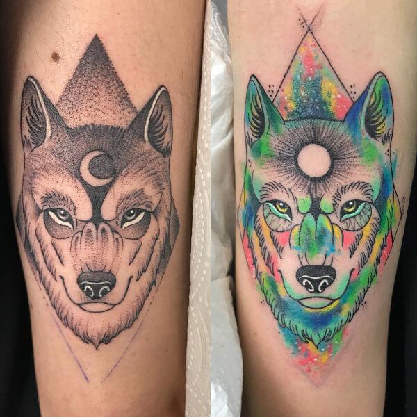 Dotwork y blackwork, Álex Baens. Tatuaje grande en brazo de lobo, luna y sol.