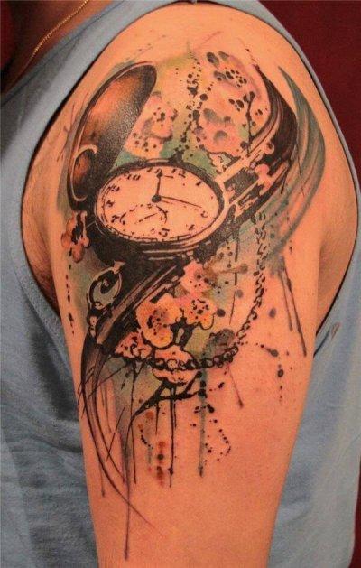 tatuaje-acuarela-reloj-hombre