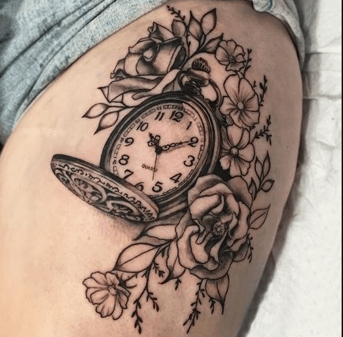 tatuaje-reloj-pulsera-con-flores-muslo